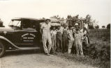 Man and boys beside a truck circa 1935
