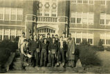 Harold Garver and F.F.A. boys outside a large building