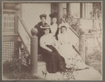 Four women on the porch of a house in Olathe circa 1900